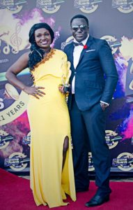 Dennis Wambi (right) and a colleague, Tricia Wabito, during the 11th edition of Groove Awards Kenya.